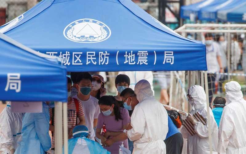 Pequim aumenta capacidade de teste e chega a um terço da população